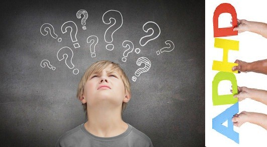 Thinking child looking at question marks above his head